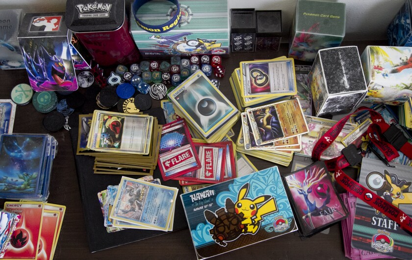 FILE - This May 5, 2016, file photo shows Pokemon merchandise. Target has suspended in-store sales of sports and Pokemon trading cards, citing safety concerns. While the Minneapolis-based retailer didn't give a direct reason for the change in its Friday, May 14, 2021, announcement, the Minneapolis Star Tribune says it came after police in Brookfield, Wis., reported that four men had attacked another man over cards on May 7. (Mike Lang/Sarasota Herald-Tribune via AP)