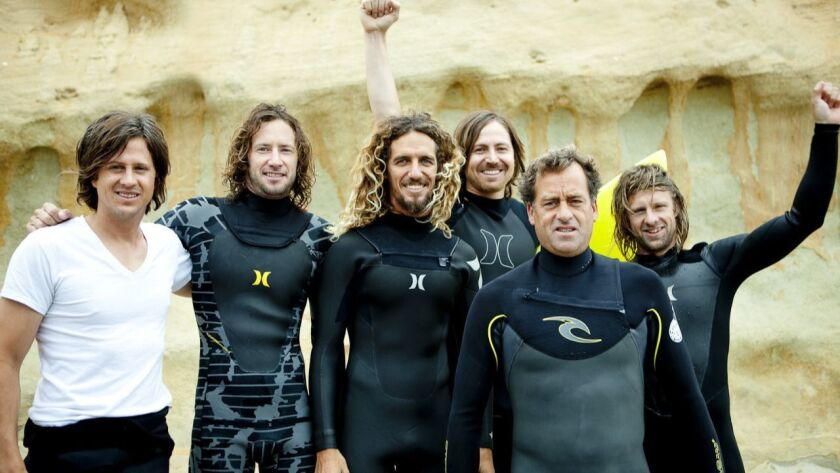 Tom Curren, second from right, in 2012 at the Switchfoot Bro-Am surfing event at Moonlight Beach with, left to right, Tim Foreman, Tim Curran, Rob Machado, Chad Butler, Curren and Jon Foreman.