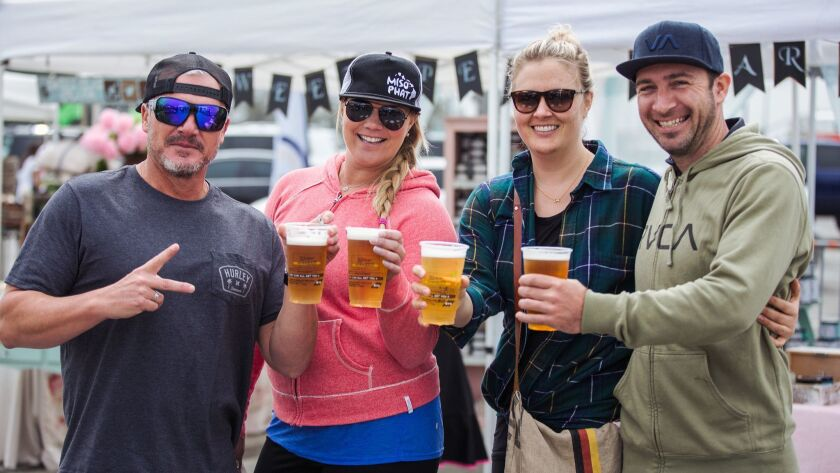 Patrons enjoy beer at the weekly OC Marketplace, which will be holding a luau and craft beer festiva