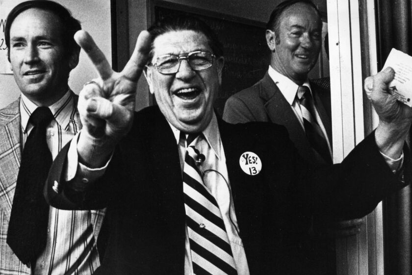 Howard Jarvis, chief sponsor of the controversial Proposition 13, signals victory as he casts his own vote at the Fairfax-Melrose precinct. June 6, 1978 photo by Ben Olender/Los Angeles Times. For From The Archives.
