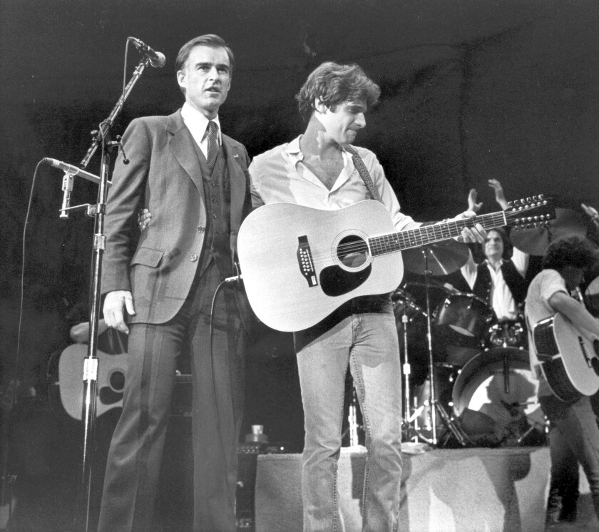 California Gov. Jerry Brown, left, is introduced by Glenn Frey of the Eagles during a presidential fundraising rock concert at the San Diego Sports Arena in December 1979.