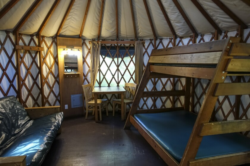 There are several Yurts available for rent in Cape Lookout State Park. They sleep 5, have heat, lights, outlets, locking front door and covered porches.