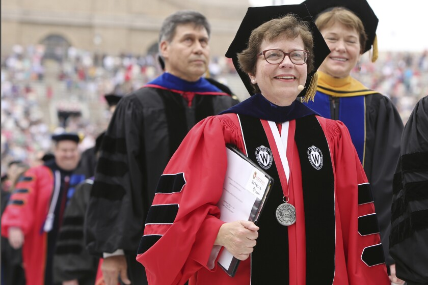 FILE - In this May 16, 2015 file photo, Chancellor Rebecca Blank, center, walks in a procession at the start of the University of Wisconsin-Madison spring commencement ceremony in Madison, Wis. Blank, chancellor of University of Wisconsin-Madison, Wisconsin's flagship campus, has been named the next president of Northwestern University, Northwestern's Board of Trustees announced Monday, Oct. 11, 2021. She will become Northwestern's 17th president, effective in the summer of 2022. (Amber Arnold/Wisconsin State Journal via AP, File)