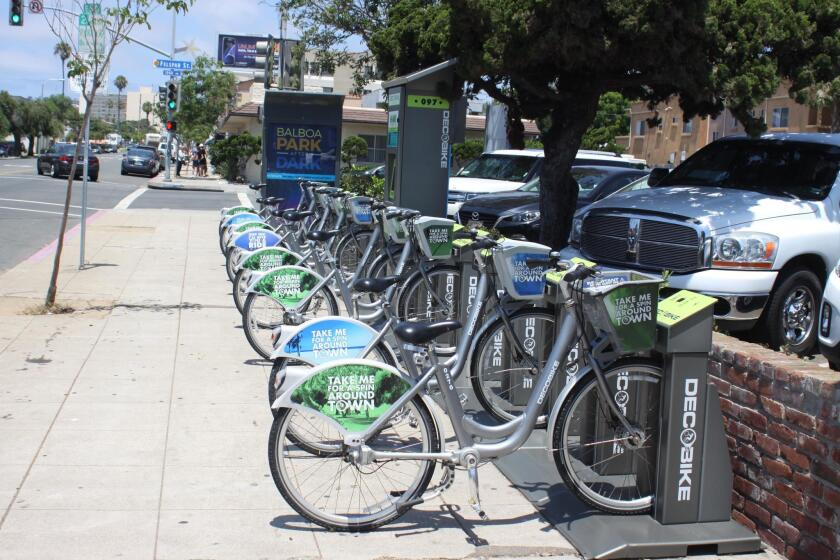 In Pacific Beach, some DecoBike kiosks are stationed on sidewalks.