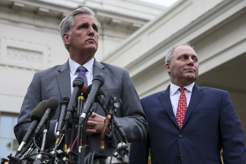 Rep. Kevin McCarthy (R-Bakersfield), left, with Rep. Steve Scalise (R-La.), talking to reporters outside the West Wing of the White House on Jan. 2.