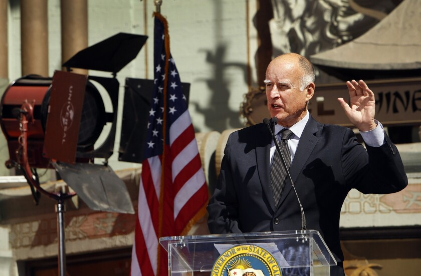 "In his veto message, Gov. Jerry Brown wrote there's no reason to believe public safety employees ""will need substantially more time than other injured workers to recover."" Above, Brown speaks at an event last month."