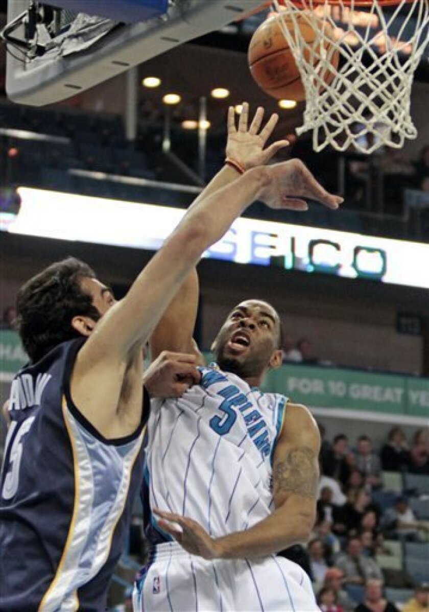 New Orleans Hornets guard Marcus Thornton (5) goes to the basket over Memphis Grizzlies center Hamed Haddadi (15) in the first half of an NBA basketball game in New Orleans, Wednesday, March 3, 2010. (AP Photo/Bill Haber)