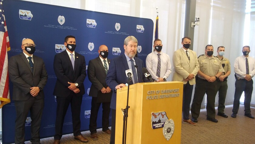 Scott County Attorney Mike Walton speaks during a news conference with Davenport law enforcement officials, Wednesday, May 5, 2021, in Davenport, Iowa. Henry Dinkins, a registered sex offender, has been charged with murder and kidnapping in the shooting death of a 10-year-old Iowa girl who went missing last summer, a Walton announced Wednesday. (Tony Watt/The Dispatch – The Rock Island Argus via AP)