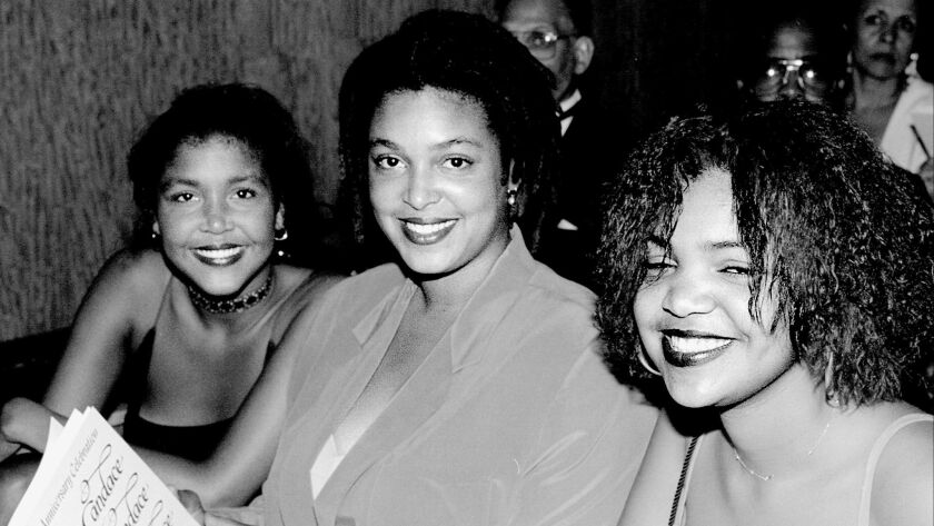 Ensa Cosby, left, with her sisters Erika and Evin at the Candace Awards presentations at the Metropolitan Museum in New York in 2004.