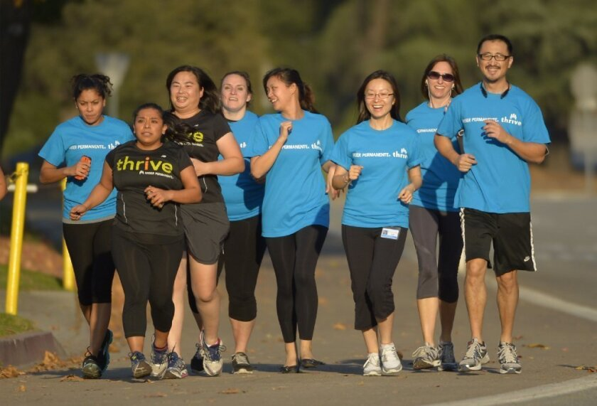 Kaiser Permanente employees exercise together in Pasadena. The nonprofit health plan has a dominant share of California employers and individual customers, research shows.