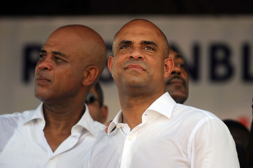 Haitian President Michel Martelly, left, and Prime Minister Laurent Lamothe at an event in Port-au-Prince, Haiti, in October. Lamothe announced his resignation Sunday.