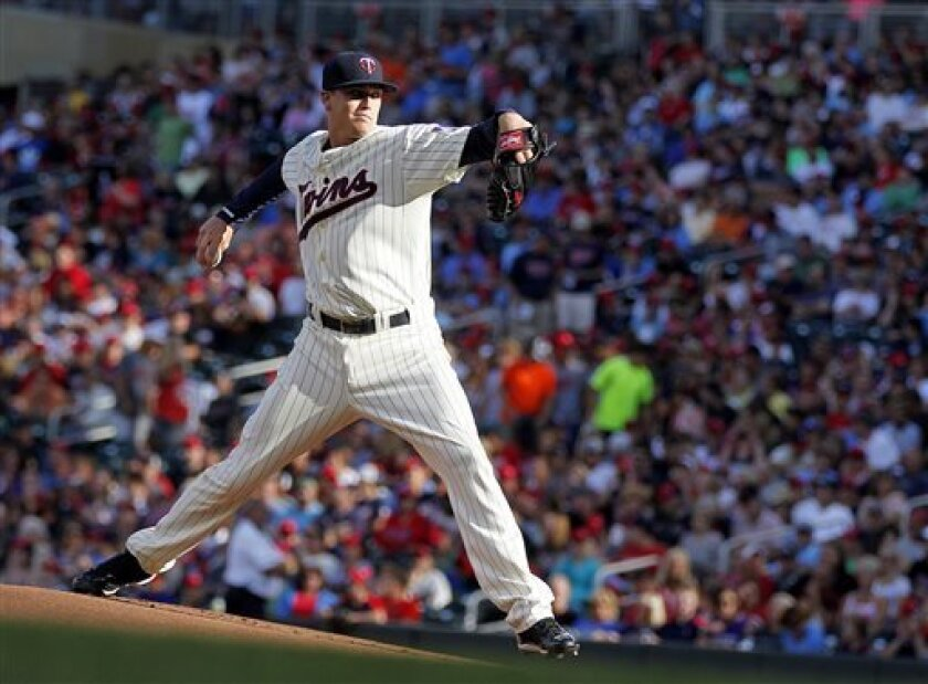 Minnesota Twins starting pitcher Kyle Gibson throws to the Houston Astros in the first inning of a baseball game in Minneapolis Saturday, Aug. 3, 2013.(AP Photo/Andy Clayton-King)