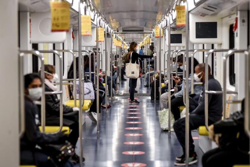 Subway passengers in Milan, Italy