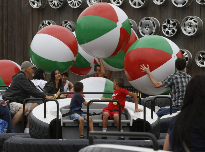 Visitors toss beach balls into the air while they float on a cushion of air at Luigi's Flying Tires during the Cars Land debut to the public at the Disney California Adventure on June 15, 2012. The ride was closed in February 2015.