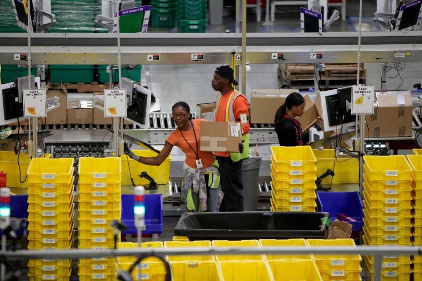 Workers at Amazon's fulfillment center in San Bernardino.