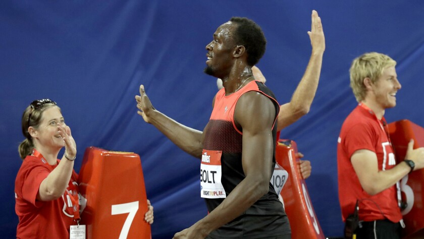 Usain Bolt is congratulated after winning the 200-meter race at a Diamond League event in London on Friday.