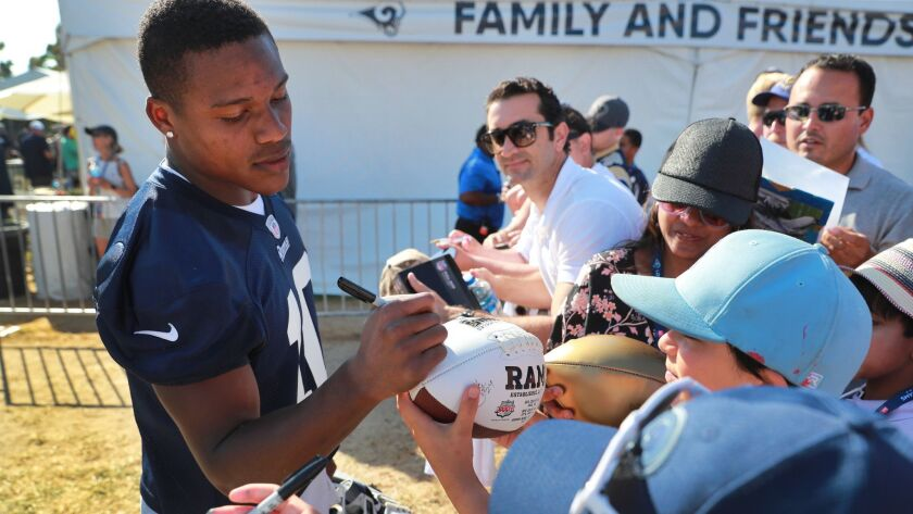 IRVINE, CALIF. -- MONDAY, AUGUST 13, 2018: Rams wide receiver Pharoh Cooper signs autographs for fan