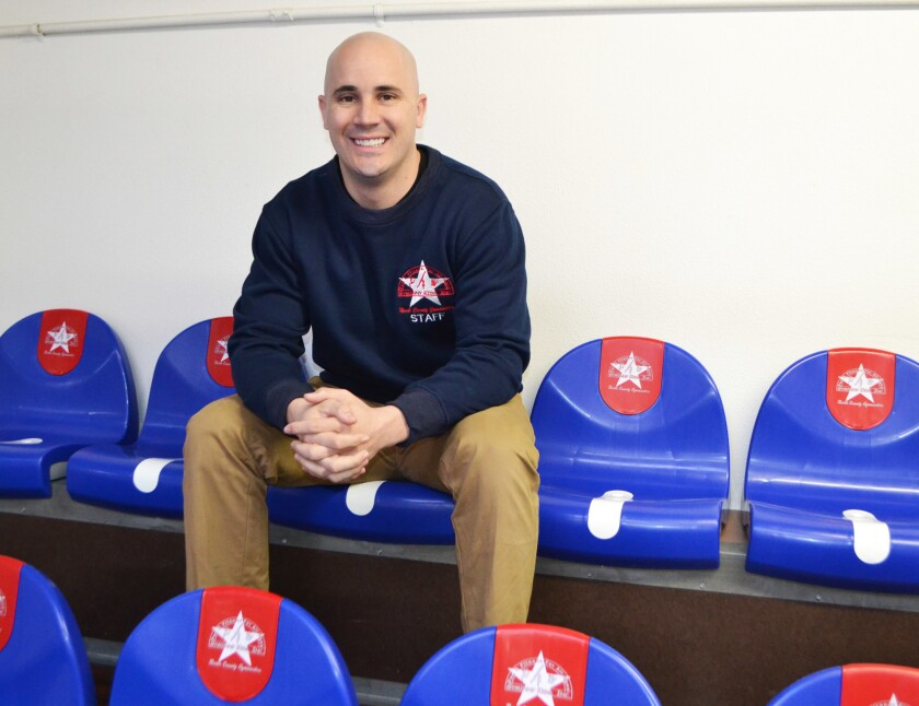 Director of Operations Daniel Grundert in the new seating for parents on the gymnasium's second floor.