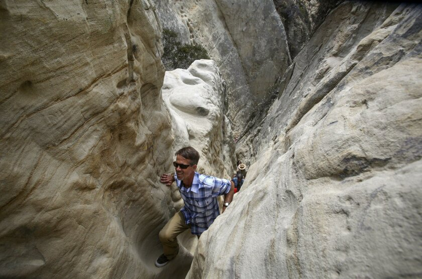 San Elijo Lagoon Conservancy Executive Director Doug Gibson climbs up a steep, narrow section of the more challenging route of Annie's Canyon Trail Tuesday, at San Elijo Lagoon Ecological Reserve.