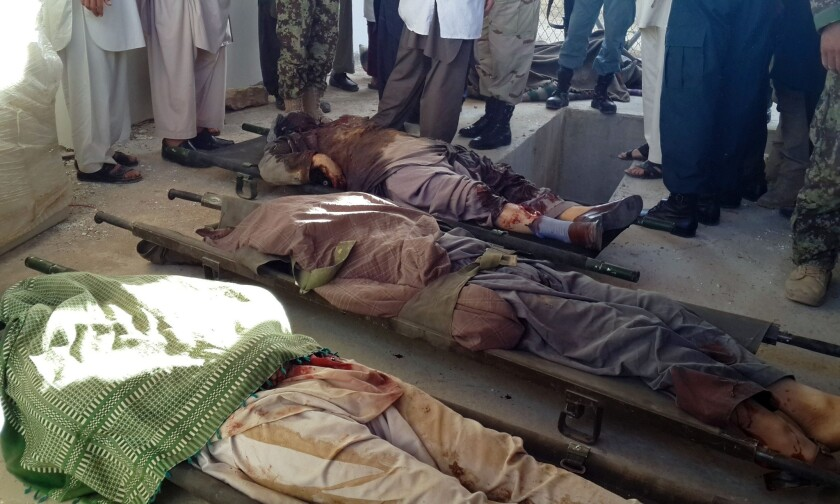 Bodies of Shiite Muslims shot to death after Taliban insurgents stopped their vehicles in Afghanistan's Ghor province on July 25.