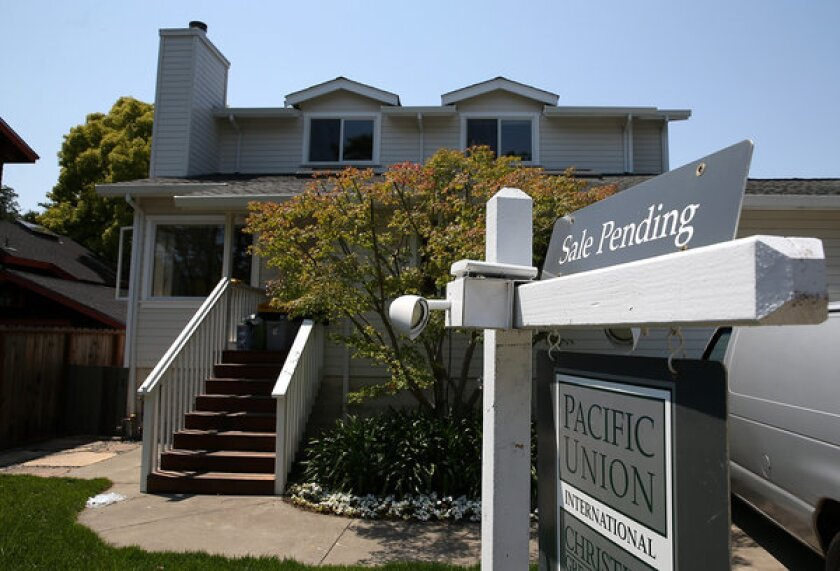 A sale pending sign is posted in front of a home in San Anselmo, Calif.