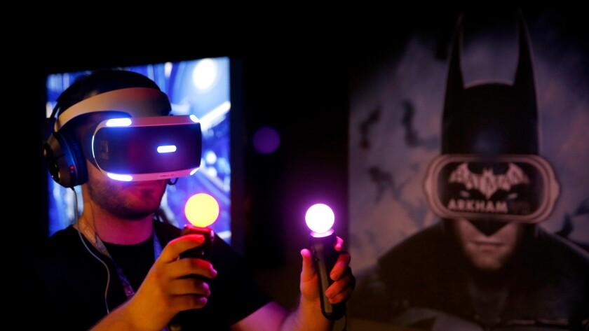 "Jordan Maron plays Warner Bros. Interactive Entertainment's ""Batman: Arkham VR"" at this year's Electronic Entertainment Expo."