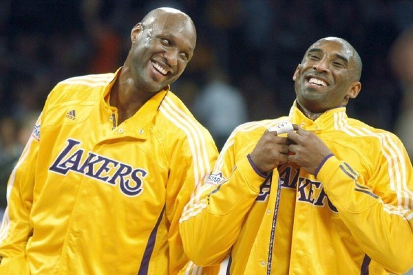 Kobe Bryant, right, shares a laugh with then-Lakers teammate Lamar Odom before a game in 2010.