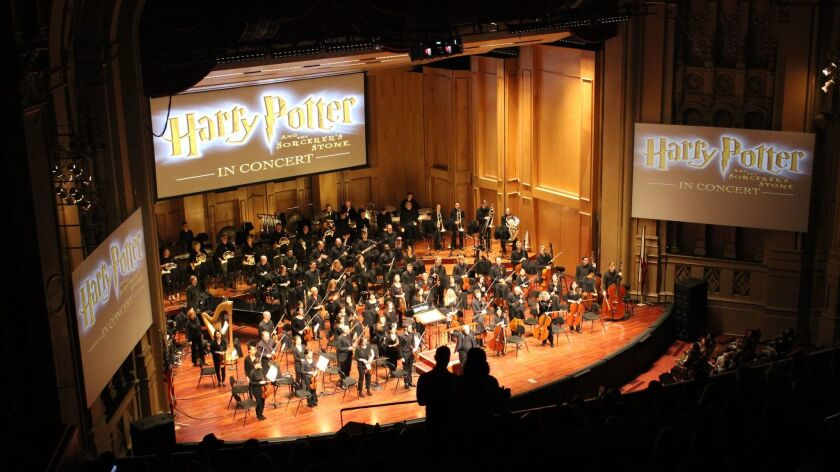 """The San Diego Symphony orchestra accompanied a showing of """"Harry Potter and the Sorcerer's Stone"""" at a soldout weekend concert."""
