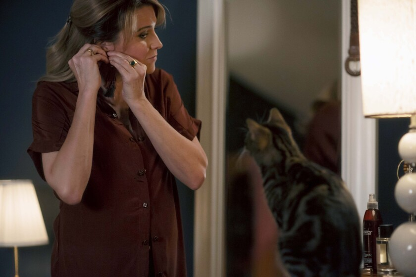 "Lucy Lawless with a cat in ""My Life Is Murder"""