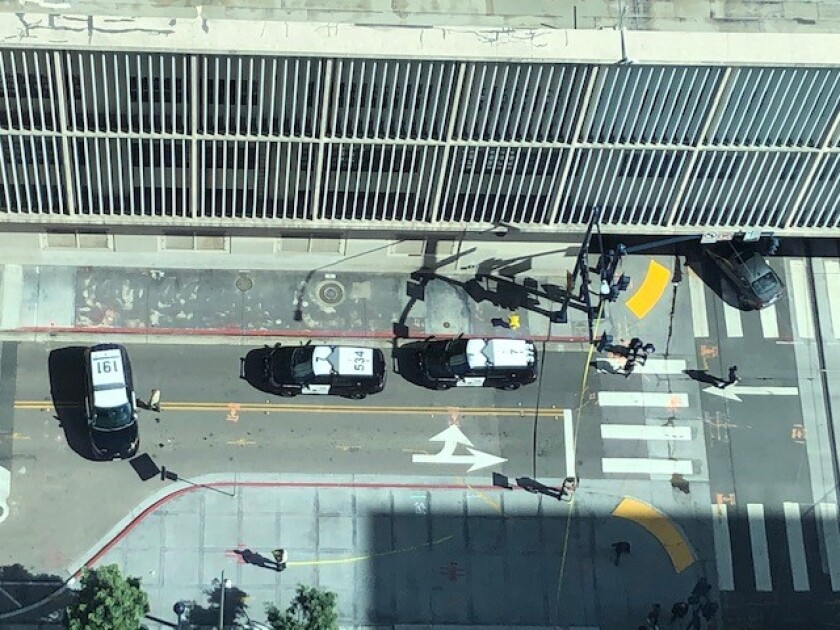 Authorities blocked the intersection of Union and C streets, as seen from the 17th floor of the downtown San Diego courthouse, in response to a suspicious box found outside. A bomb squad later gave the all-clear.