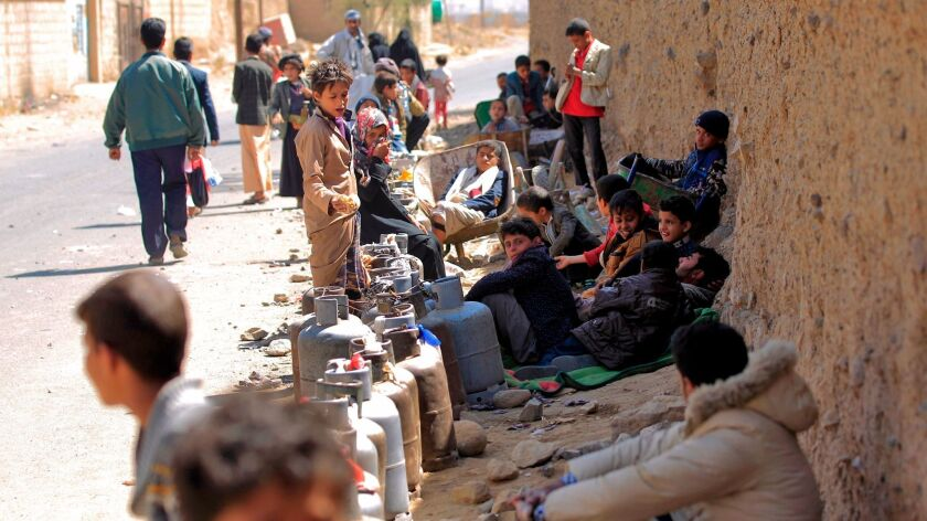 Yemenis wait next to empty cylinders for gas supplies Nov. 9, 2017, amid increasing shortages in the capital, Sana.
