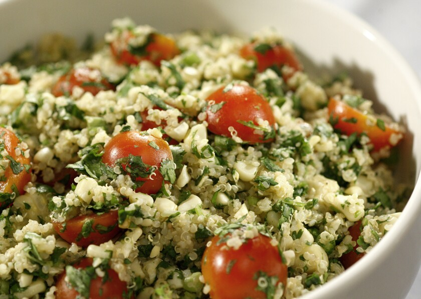 Quinoa salad with grilled corn, tomatoes and cilantro