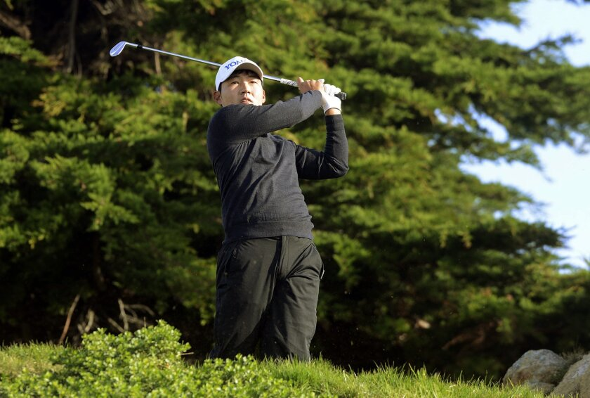 Sung Kang, of South Korea, hits from the 11th tee of the Monterey Peninsula Country Club Shore Course during the second round of the AT&T Pebble Beach National Pro-Am golf tournament Friday, Feb. 12, 2016, in Pebble Beach, Calif. Kang co-leads the tournament after shooting an 11-under-par 60. (Davi