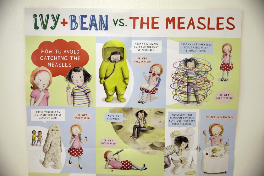 """A poster about measles is displayed at the Tamalpais Pediatrics clinic in Greenbrae, Calif. Health officials are warning parents against considering """"measles parties"""" to intentionally expose their children to the disease."""