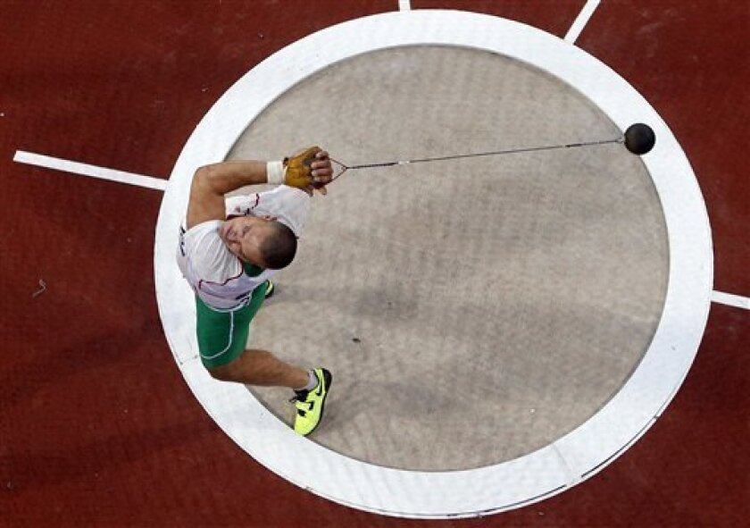 Hungary's Krisztian Pars competes in the men's hammer throw final during the London 2012 Olympic Games at the Olympic Stadium, Sunday, Aug. 5, 2012, in London. (AP Photo/Fabrizio Bensch, Pool)