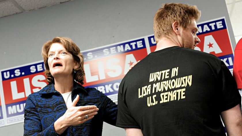 Alaska Sen. Lisa Murkowski with a supporter at a rally in Juneau in 2010, when she had to mount a wr