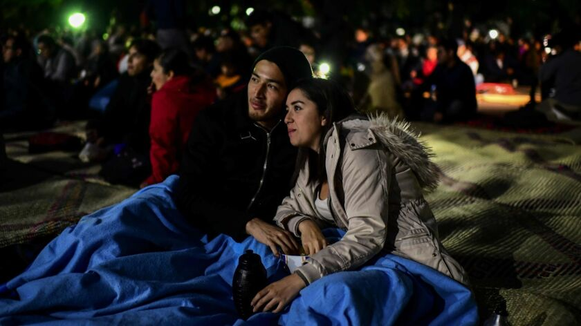 """A couple watch the movie """"Roma"""" by Mexican director Alfonso Cuaron, in the former presidential residence of Los Pinos, now converted into a cultural center in Mexico City on Thursday."""
