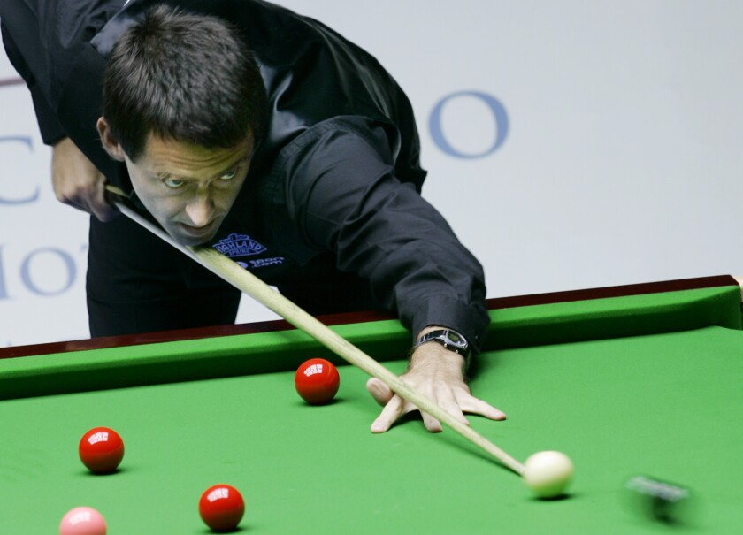 """FILE - In this Thursday, July 12, 2007 file photo Ronnie O'Sullivan of England aims a shot during an invitation match against Supoj Saenla of Thailand during the """"Euro-Asia Master Challenge 2007"""" in Hong Kong. Ronnie O'Sullivan became world snooker champion for the sixth time and at the age of 44 by beating fellow Englishman Kyren Wilson in the final on Sunday, Aug. 16, 2020. O'Sullivan moved to within one of the all-time record of world titles, held by Stephen Hendry, and tied the number won by Steve Davis and Ray Reardon. (AP Photo/Kin Cheung, File)"""