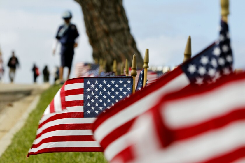 American flags are placed at headstones at Fort Rosecrans National Cemetery in honor of Memorial Day.