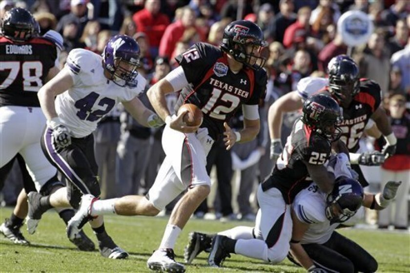 Texas Tech quarterback Taylor Potts (12) scrambles with the ball in the second quarter of the TicketCity Bowl NCAA football game against Northwestern in Dallas, Saturday Jan. 1, 2011. (AP Photo/Sharon Ellman)