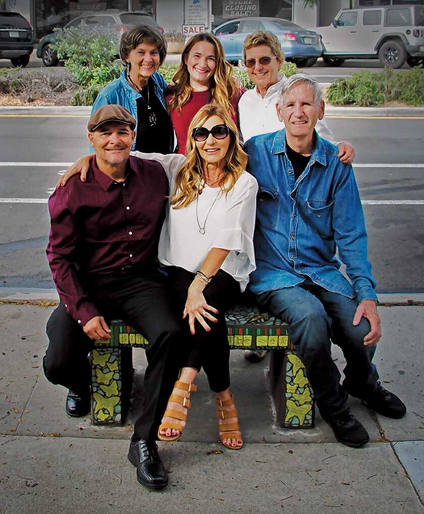 "Front row: Thom Kezas, Krista Robbins and AJ Mason. Back row: Jane Wheeler, Michaela Kezas and Barbara Dunbar. Bird Rock Community Council added this new community bench to its series titled ""Dancing Through Life."" The mosaic bench was dedicated Sept. 22, 2019 at 5643 La Jolla Blvd. to honor Joanne Mason."