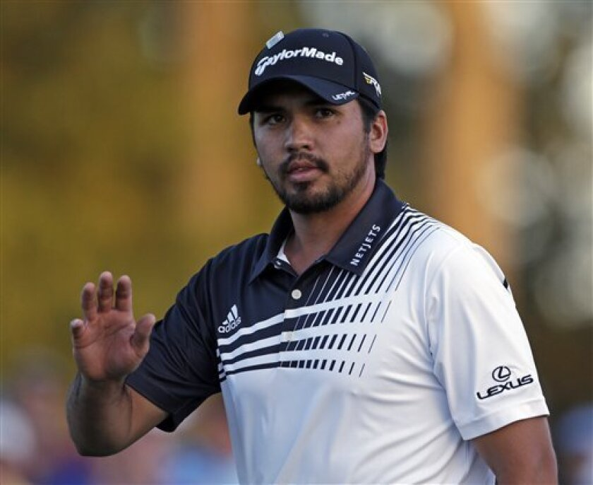 Jason Day, of Australia, waves to the gallery on the 18th hole during the second round of the Masters golf tournament Friday, April 12, 2013, in Augusta, Ga. (AP Photo/David Goldman)