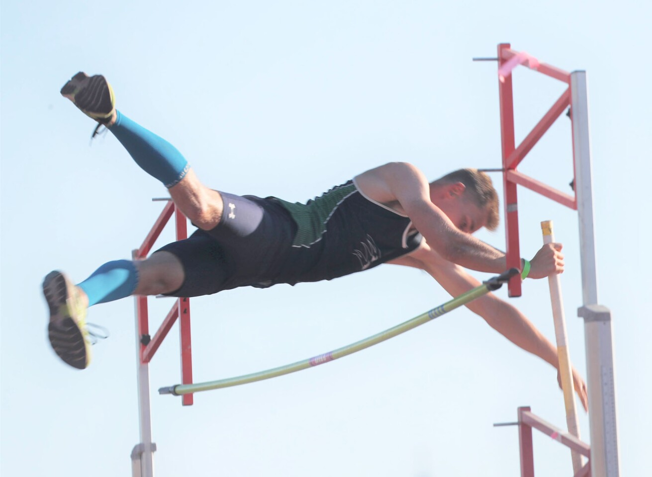 Del Norte's Aidan Rosen competing in pole vault.