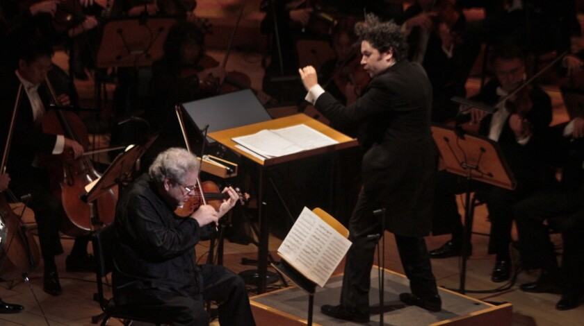 Violinist Itzhak Perlman performs with Gustavo Dudamel conducting the Los Angeles Philharmonic during it's season-opening gala concert at Walt Disney Concert Hall on Sept. 30, 2014.