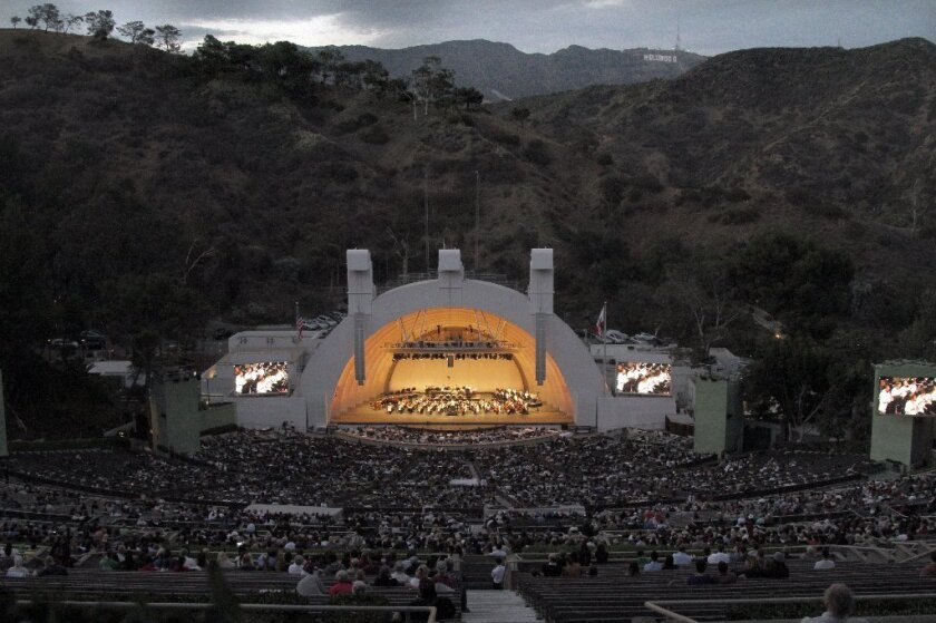 The Hollywood Bowl and surrounding hills at dusk.