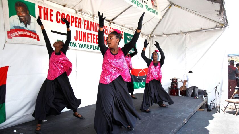 This file photo shows a celebration of Juneteenth in 2018 on Imperial Avenue in San Diego sponsored by the Cooper family.