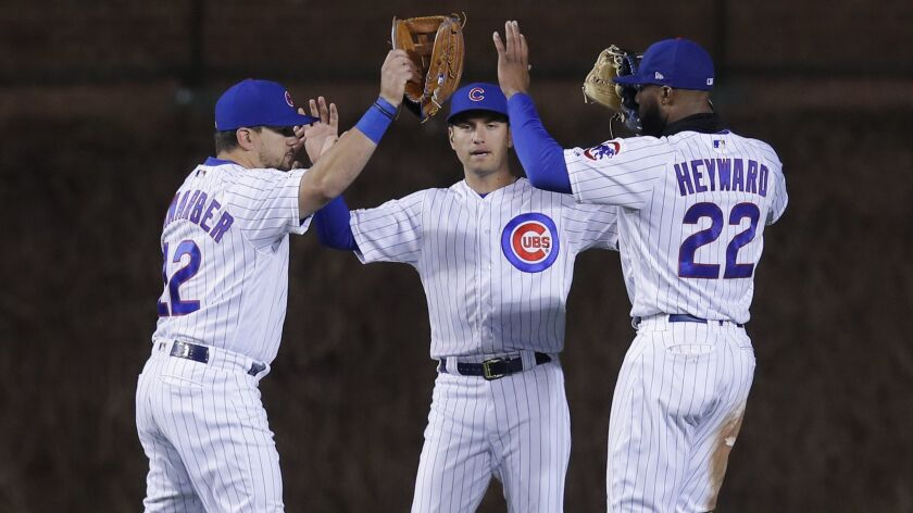 Outfielders Kyle Schwarber, Albert Almora Jr. and Jason Heyward, from left, celebrate the Chicago Cubs' 7-2 victory over the Dodgers on Tuesday in Chicago.