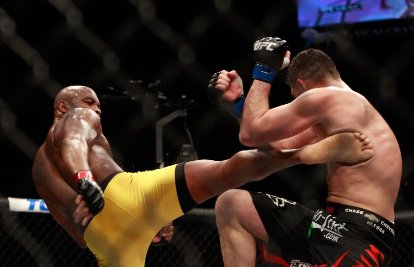 Anderson Silva lands a kick against Nick Diaz during their middleweight fight at UFC 183 on Saturday night in Las Vegas.