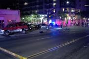 Mortuary van with body chases hit-run pickup into downtown San Diego, where truck crashes