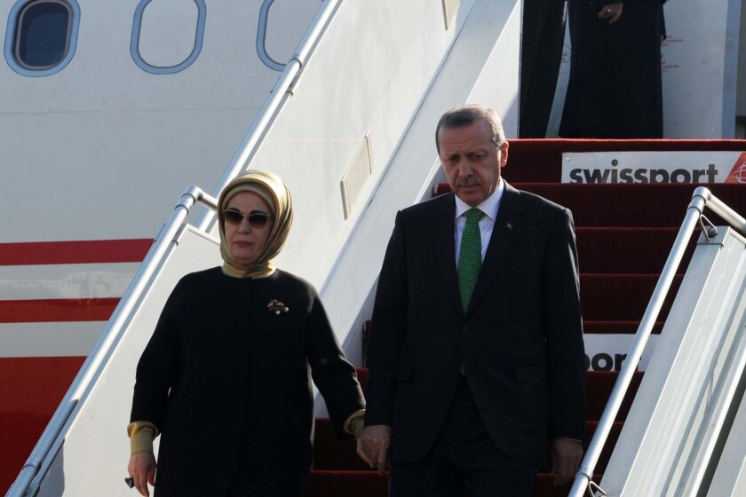 Turkish President Recep Tayyip Erdogan, shown here on Wednesday arriving in Algiers with his wife, Emine, calls motherhood women's highest role and urges Turkish women to have at least three children.
